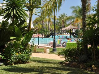 Modern ground floor apartment, poolside, in beach front complex Las Adelfas