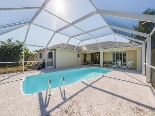 Tropical Getaway w/ Screened Lanai & Heated Pool - Near Golf, Shops & Dining