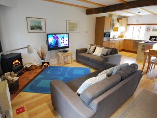 Here's the relaxing lounge area with 42inch Freeview TV, wood burning stove and comfy seating for 4.