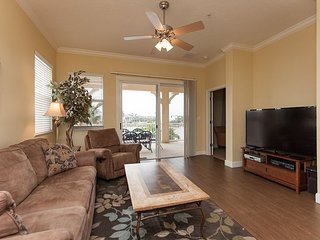 Lovely 2nd floor lake view corner unit ! Largest floor plan in the community!