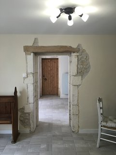 lounge to kitchen with feature beams and stone work