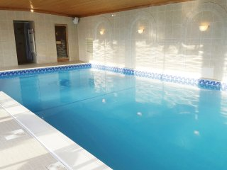 Swimming pool with shower and sauna
