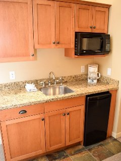 The kitchenette includes a microwave, mini-fridge and coffee maker.