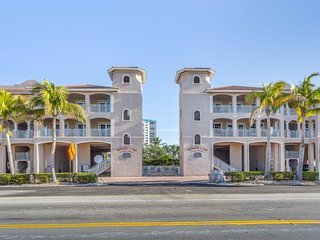 Walk to beach & enjoy a shared pool from the comfort of this waterfront condo