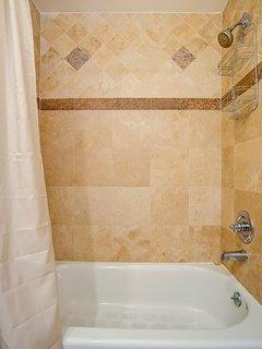 Master bathroom shower/tub.