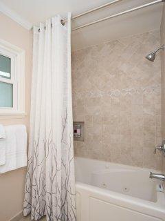 Bathroom has shower/tub combination