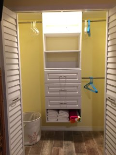 Large closet with lots of storage & hanging space.