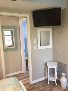Wall mounted 30' Smart T.V in the bedroom.