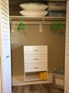 Closet with lots of storage and hanging space.
