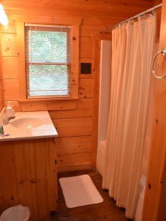 Main floor bathroom has a laundry area.  All baths have single sink, shower-tub combo, toilet, and storage space