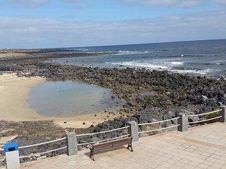 Caleta de Famara, first sea line, white bahia beach infront