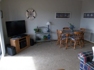 Dinette set for 4, plus bar stools in the kitchen area and patio set for 2 on the balcony for meals