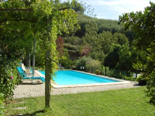 With private swimming pool and well kept and spacious lawned garden.