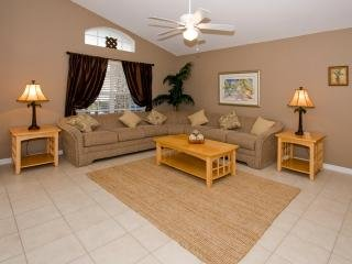 The Living Room is bright and spacious. The furnishings can easily accomodate more guests.