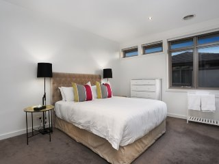 2 - spacious main bedroom at rear of building, with walk-in robe and double-shower en-suite