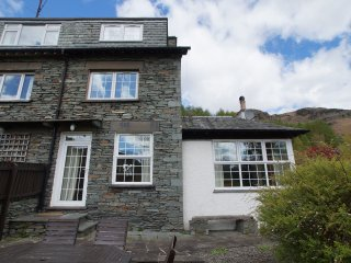 PLUMBLANDS, three storey cottage, views of Langdale Fells, terrace garden, in