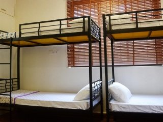 Single bed in a commodious dorm with a shared pool, 1 km away from Vagator Beach