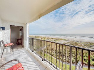 Oceanfront condo with sweeping water views, shared pool, & direct beach access