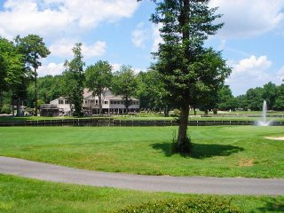 Dog-friendly condo with shared pool plus lake, canal, and golf course views