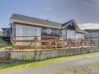 Festive oceanfront home with room for four guests + 2 dogs!