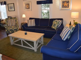 Recently updated living room with new floors, new window treatments, and fresh paint!