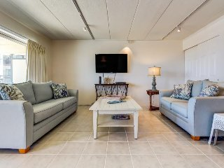 Updated condo w/ shared pool, balcony, & ocean view - walk to the beach