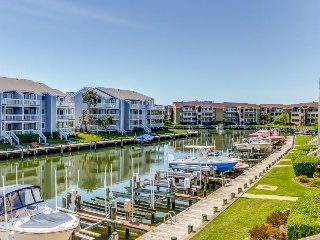 Canalfront condo w/ deck, balcony, two shared pools & a dock - walk to beach!