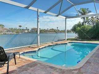 Private waterfront home w/ heated pool & impressive water view