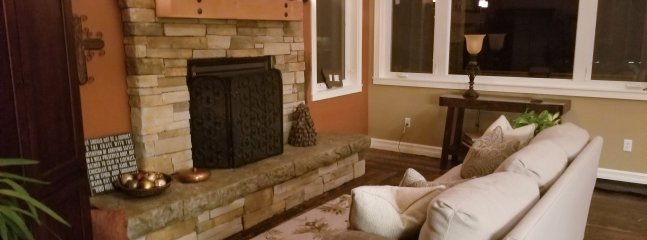 Great Room sitting area with gas fireplace and TV equipped with DISH Network