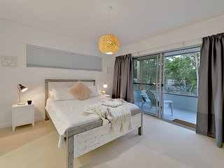 Front deluxe bedroom with balcony overlooking the tall gum trees