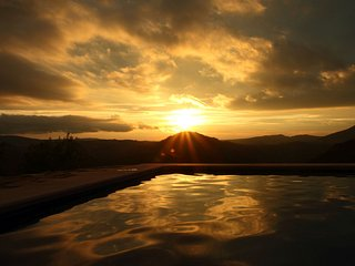 The gorgeous golden glow of the sunset, reflected in the pool