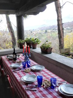 Table on the patio with view on Monte Grappa and garden