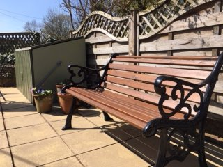 Wrought Iron Garden Furniture, 2 benches, 2 chairs and a lovely large table with umbrella.
