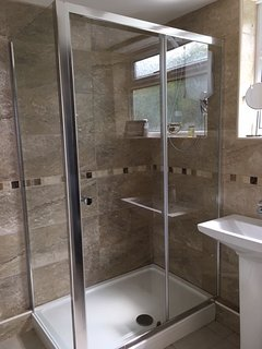 Large double shower enclosure, with Mira electric shower.