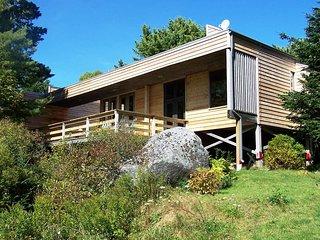 Frances Louis House nestled among the trees in Port Joli, Nova Scotia