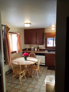 Fully stocked kitchen with appliances, dishware, dishwasher, stove, refrigerator & microwave