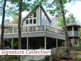 Fall in love with the tall timbers, level lakefront, and private dock at