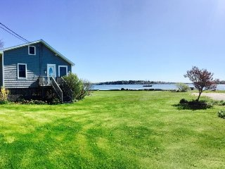 Recently renovated cottage with sweeping views of Harpswell Sound and beyond.
