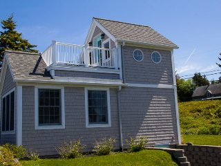 Couples cottage at the head of Mackerel Cove with views to Mt. Washington.