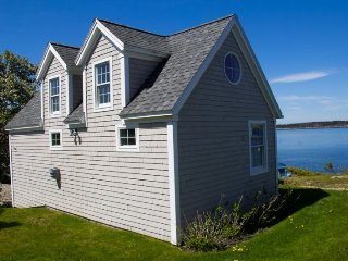 Nautical Themed oceanfront cottage located at the head of beautiful Mackerel Cov
