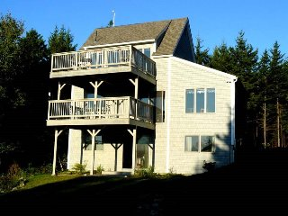 Beautiful 5 bedroom home just a short walk to local beach and ocean views from t