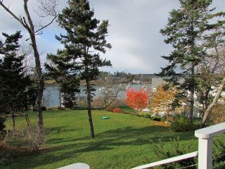 Two bedroom cozy cottage with beautiful views of Mackerel Cove and the Bay!
