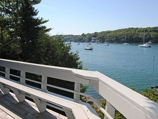 Great for large family with four bedrooms, private dock and beach within walking