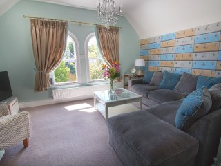 Lovely interior design in the large open plan living room Riverside Apartment Chester