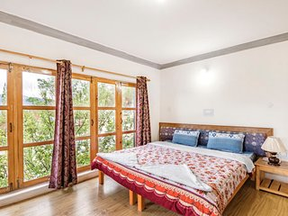 Pleasant room in a guest house with a blissful alpine view