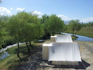 Six riverside tents, ideal for a picturesque group retreat