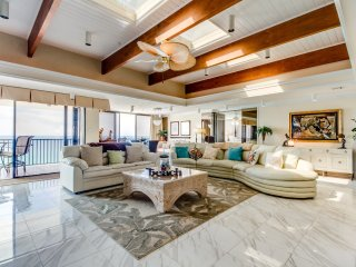 Fully Renovated ~ Luxury PENTHOUSE on Thomas Drive ~ Beach Service Included
