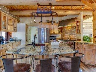 Gorgeous riverfront house w/ private hot tub & mountain views - close to ski!