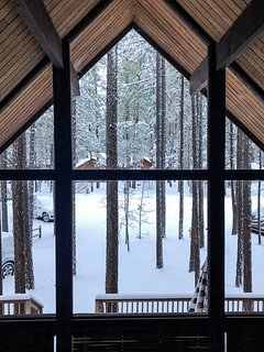 Winter brings beautiful, white, snowy scenery all around the cabin.