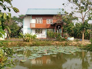 Teakwood house in rural Chiangmai in th e middle of rice fields